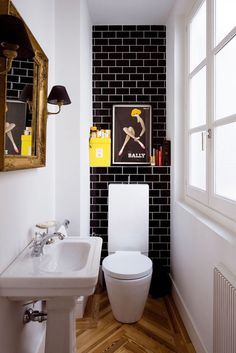 15 Incredible Small Bathroom Decorating Ideas - black subway tiles with white grout, chevron wooden floors, clean white walls + pops of yellow bathroom design Black Subway Tiles, Black Tiles, Downstairs Bathroom, Master Bathroom, Bathroom Black, Vanity Bathroom, Budget Bathroom, Bathroom Remodeling, Funky Bathroom