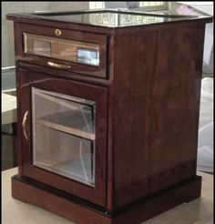 End Table Cigar Cabinet. After many requests finally Cigar Star comes through with a large 600 cigar End table Cigar humidor. Quality with class! This humidor really does add style to my stogies!