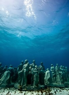 Jason desCaires Tayler, from The Silent Evolution.  These are sculpture reefs....