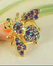joan rivers blue crystal bee pin