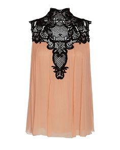 Exclusive for Intermix Lace Neck Trim Pleated Top: A contrast lace trim at the decolletage mixed with a pleated silk georgette bodice speaks to the feminine. Keyhole back with three covered button loop closures at nape. Sleeveless. In blush/black. Fabric: 100% silk Made in China. Model Measurements: ...