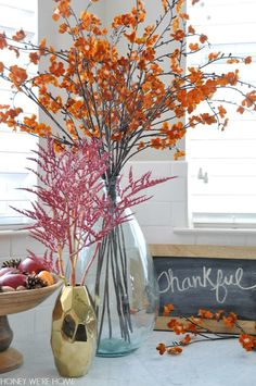 Mixing faux and real flowering branches in Fall decor