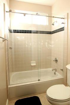 shower/tub enclosures | ... frameless polished or brushed stainless steel bypassing tub enclosure