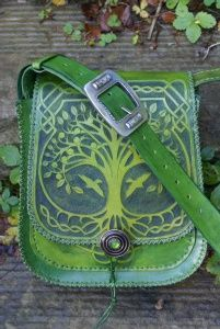 ornately hand carved messenger bag with Tree Of Life and Ivy Green Man pocket panels    Sky Raven Wolf
