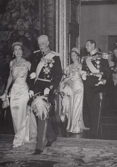 King Gustaf Adolf V of Sweden with his grand daughter Queen Ingrid of Denmark and behind them  Princess Louise of Sweden and King Frederick IX of Denmark