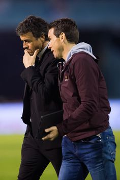 Head coach Luis Enrique Martinez of FC Barcelona speaks to his assistant coach Juan Carlos Unzue during the La Liga match between Celta Vigo and FC Barcelona at Estadio Balaidos on April 5, 2015 in Vigo, Spain.