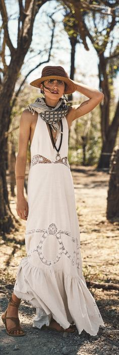 A lacy white maxi dress, lace-up gladiator sandals, boho jewelry, a scarf and fedora make for a cool vacation look. Vacation Style Inspiration: Free People's New Campaign Is a Bohemian Summer Daydream