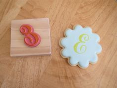 Piping letters on cookies