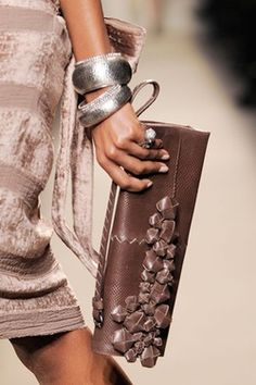clutch and silver bangles