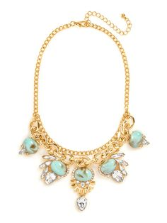 Talk about tough love, this decadent bib comes complete with luxe turquoise and clear gems, all set amongst edgy chains and crystal spikes.
