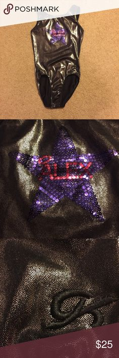 Adult extra small AXS GK gymnastics leotard (Alex) GK gymnastics leotard. Size adult extra small. Personalized with Alex on the front purple star with pink lettering. Leotard is a steel gray mystique color. Leotard measures approximately 11 inches across chest when lying flat and approximately 22 inches from shoulder seam to crotch unstretched. GK Other