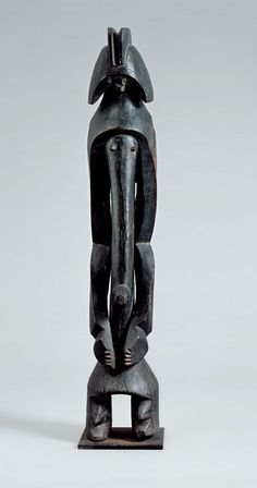 brunoclaessens.com African art from the Beyeler Foundation Cult Figure, 19th or early 20th century Unknown master from the Mumuye region, Nigeria Wood with shiny dark patina, height 99 cm (including pedestal) Photo: Robert Bayer, Basel