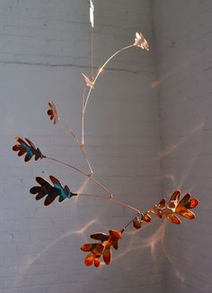 Ive been creating Art with Leaves for ten years now and this and this Gingko Leaf Mobile is handmade hammered copper. The idea of having leaves in art