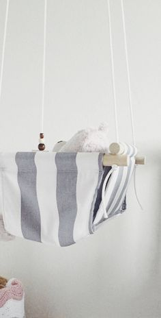 A personal favorite from my Etsy shop https://www.etsy.com/listing/568991071/gray-stripes-baby-swing-fabric-swing