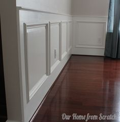 DIY Wainscoting Tutorial - You are KIDDING me!! Easy wainscoting inspired idea: buy picture frames, glue to wall and paint over entire lower half.