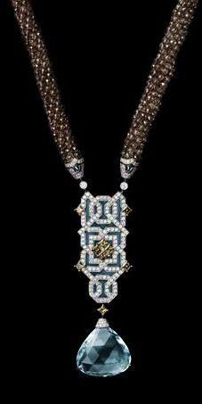 Cartier ~ White gold, one 31.59-carat fan-shaped aquamarine, brown diamonds, Paraiba tourmalines, smoked quartz beads, plique à jour enamel, brilliants.