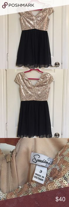 AMAZING CONDITION Sequin dress Zipper in back. Amazing quality. Worn once for New Year's Eve. Purchased from Bealls at full price. Adorable the way it is or with black tights and cute boots! This is a size 3. I wear a small and this fits perfect ✨ I don't have a use for this. I'm hoping someone will get some use out of it because it truly is beautiful. Rose gold colored sequins with some silver sequins. This was so fun to wear! speecklers Dresses Mini