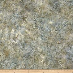 Designed for South Sea Imports, this Indonesian batik fabric is perfect for quilting, apparel and home decor accents. Colors include shades of grey and ivory.