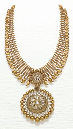 Azva contemporary bridal gold necklace of kundan stones and paisley. #Goldjewellery #luxury #style