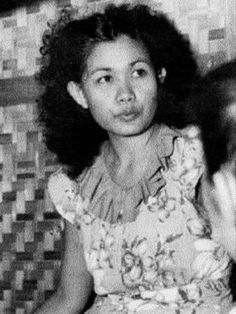 """Remedios Paraiso-Gomez, Filipina guerilla fighter called """"Kumander Liwayway"""" {Commander Dawn), 1940s -- This terror in the battlefield would fix her hair and nails  and her apply bright red lipstick before each encounter. #kasaysayan #HERstory Bright Red Lipstick, Filipina, Guerrilla, Red Lipsticks, Young Women, Her Hair, Hair And Nails, Philippines, Elegant"""