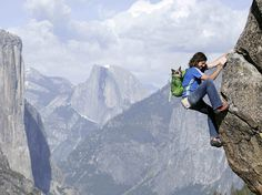 Picture of Dean Potter climbing in Yosemite with his dog whisper