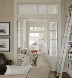 Built in book shelves with ladder transom interior windows living room. Photo by Atlantic Archives - May 18 2019 at French Pocket Doors, French Doors Patio, Patio Doors, Interior Windows, Interior Barn Doors, Interior French Doors, French Interior Design, Contemporary Interior, Door Design