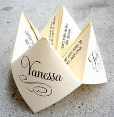 Custom designed cootie catcher for tables at reception -- fun way to learn more about bride and groom