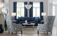 Shop Durham Navy Blue Couch with Nailheads. Styled with traditional roll-arms and a sheltering frame, the Durham sofa shows off its contemporary side in deep sapphire blue and a scattering of back pillows that let it sit a little softer and deeper. Blue Couch Living Room, Navy Blue Living Room, Blue Rooms, Formal Living Rooms, Living Room Grey, Home Living Room, Living Room Designs, Navy Blue Sofa, Living Room Furniture