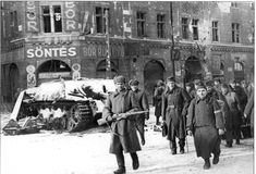 Red Army soldiers escort Hungarian POWs past a destroyed Jagdpanzer IV (Sd. in Budapest. January The Siege of Budapest December 1944 – 13 February Jagdpanzer Iv, Budapest, Tank Warfare, Ww2 Pictures, Tank Destroyer, Story Of The World, Prisoners Of War, Red Army, German Army