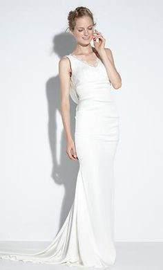f57cb3b84799 Nicole Miller FJ10003  buy this dress for a fraction of the salon price on  PreOwnedWeddingDresses