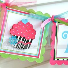 DIY birthday banner...I like how its joined together at the corners with ribbon and tulle