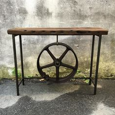 Loving all the artist intake this week!  New arrivals by Eastcote fav Paul Nelson  his pieces never last long and they are all one of a kind! This features a gorgeous #flywheel... available now at Eastcote Devon  Open until 6 tonight 11-4 tomorrow! #paulnelsonart #woodandmetal #reclaimedmaterials #industrialdesign #badass #consoletable #oneofakind #beunusual #workingfurnitureshop #artspace #localartists #devonpa #eastcotelane