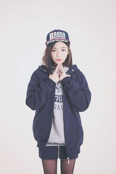 Make up also plays a role in ulzzang. Her bright pink lips bring out the lower of her face, and her eye make up makes her eyes look bigger.