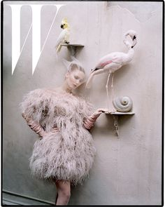 Jennifer Lawrence wore feathers and posed with two birds.