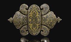 Uzbekistan | Silver-gilt nielloed belt buckle | Bukhara, 19th Century