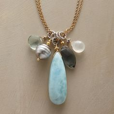 "BLUES BAND NECKLACE -- Moonstone, blue quartz, larimar, Tahitian pearl and aquamarine sing the blues as they dangle daintily from sterling silver rings and double-strand 22kt gold vermeil chains. USA. Approx. 27""L."