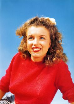 Norma Jeane in a red sweater, 1945. Photo by Andre de Dienes.