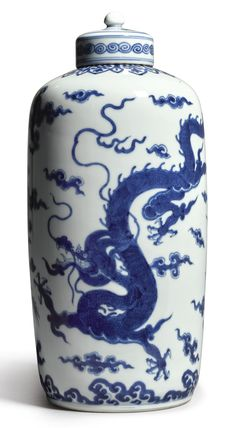 A MAGNIFICENT AND RARE BLUE AND WHITE CYLINDRICAL 'DRAGON' TEA CADDY AND COVER  YONGZHENG MARK AND PERIOD