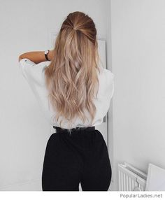 White blouse, black pants and a beautiful hair