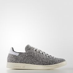 The minimalist men's Stan Smith sneaker takes on modern materials for a look…