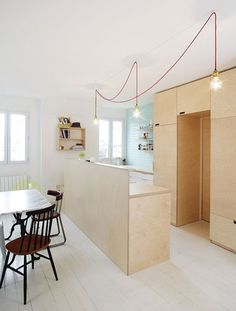 of the Week: A Compact Family Kitchen in Paris Paris kitchen remodel by Septembre Architects Lustre Industrial, Plywood Interior, Paris Kitchen, Plywood Kitchen, Kitchen Cabinet Pulls, Kitchen Lighting Fixtures, Family Kitchen, Mini Kitchen, Kitchen Dining