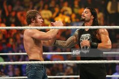 Dean Ambrose and Roman Reigns celebrate their victory at the WWE SummerSlam 2015…