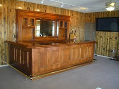 Home garage man cave conversion with a commercial size bar.
