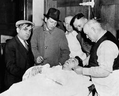 "New York: Bronx Beer Baron Bows Out. He beat many a rap, local, state, and Federal, but Arthur Flegenheimer, known as ""Dutch Schultz"" big as he was, could not escape gangland justice. Here he is on a slab in the morgue of a Newark, New Jersey hospital. (Date Photographed: October 25, 1935)"