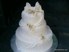 Wedding Cakes- 3 tier, fondant, white, draped fondant, lillies, sugar pearls