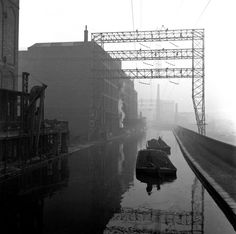 Coal barges on the heavily industrialised Liverpool end of the Leeds and Liverpool Canal c.1950.