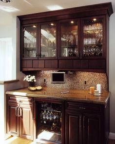 Beautiful bar design- love the backsplash and lights in the cabinets!