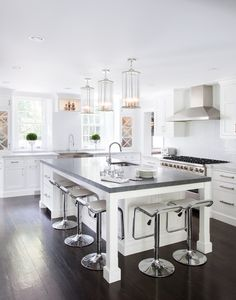 large kitchen islands with seating and storage dark floor modern chairs faucets sink chandeliers stove windows transitional kitchen of Fabulously Cool Large Kitchen Islands with Seating and Storage