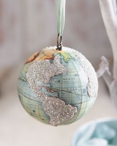 Make your own world-globe ornament, using a (wooden) ball, a map, mod podge, (and glitter, if desired. Make it extra special by either adding glitter to the countries you have been to, or the country you live in, or country of baby's birth (for baby's first ornament), etc. #HorchowHoliday14