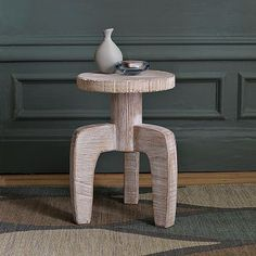 I love the White Wood Stool Side Table on westelm.com